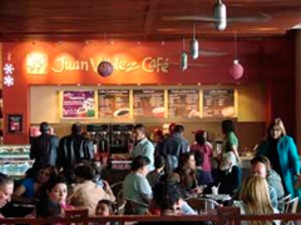 La red de franqucias Juan Valdez Café se asocia con Marca País